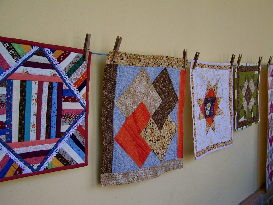 quilts hanging on a wire