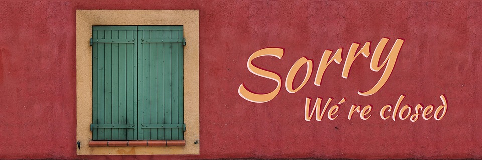 sorry we are closed - shuttered window on red background