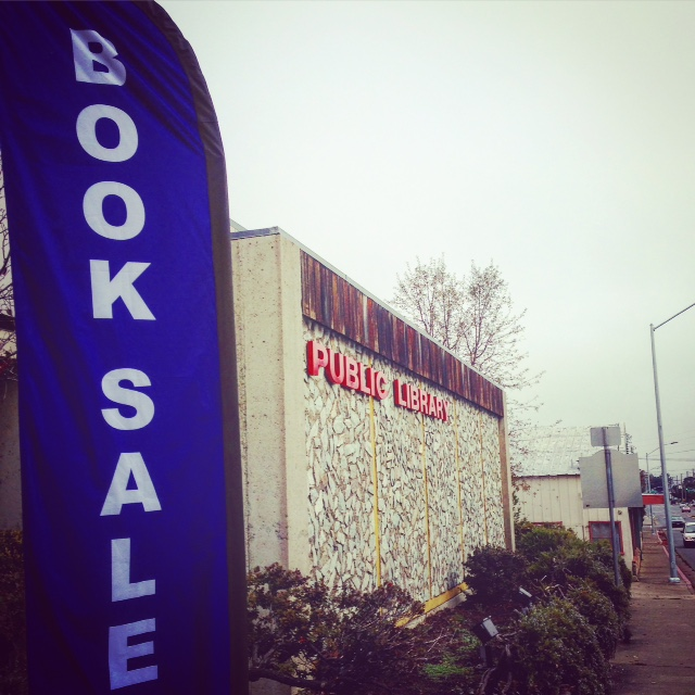 Blue book sale sign outside of Ukiah Public Library