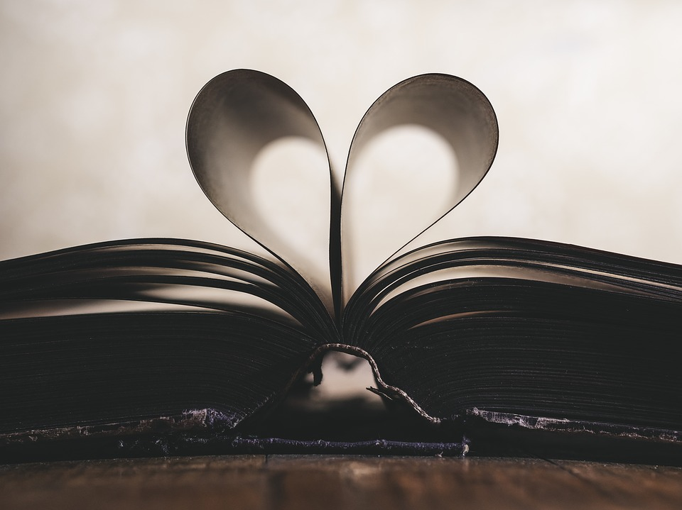 book with pages curled to look like heart