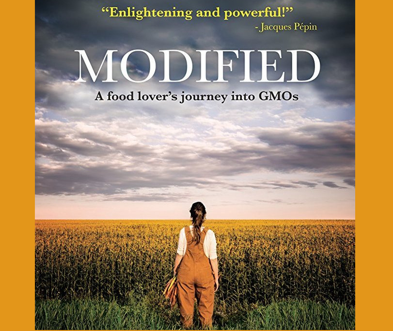 Modified  title with woman in overalls in corn field